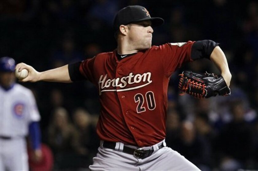 Houston Astros starting pitcher Bud Norris delivers during the first inning of a baseball game against the Chicago Cubs, Tuesday, Oct. 2, 2012, in Chicago. (AP Photo/Charles Rex Arbogast)