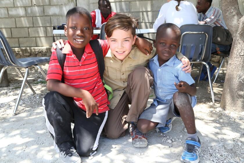 Jamesly Cine, Van Sunt of La Jolla and Nathanial Rosen at the school in Haiti