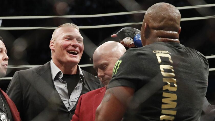 Brock Lesnar, left, taunts Daniel Cormier after Cormier's heavyweight title mixed martial arts bout
