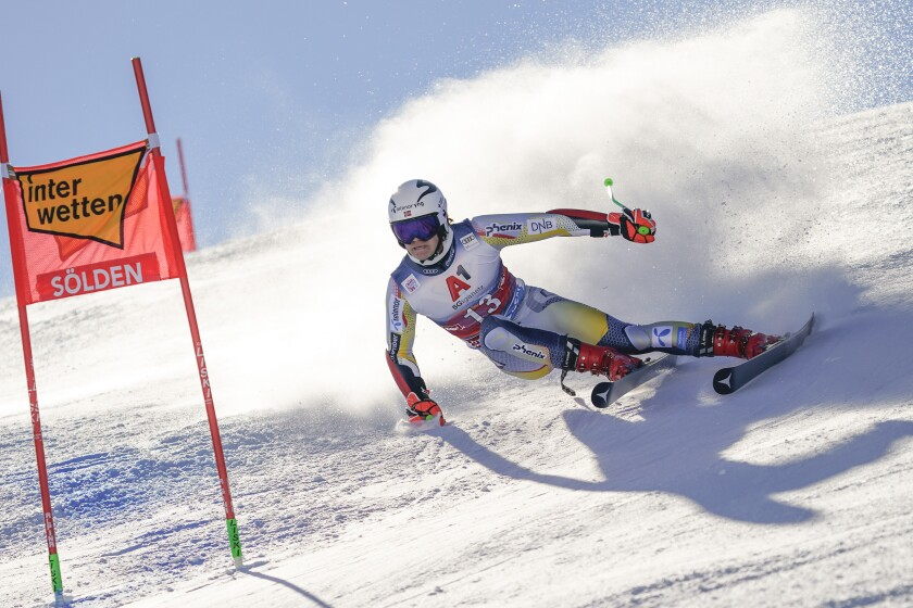 Norway's Lucas Braathen speeds down the course on his way to win an alpine ski, men's World Cup giant slalom in Soelden, Austria, Sunday, Oct. 18, 2020. (AP Photo/Giovanni Auletta)