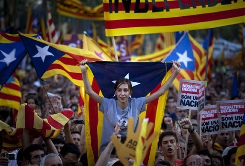 Demonstrators hold catalan flags and shout slogans as they take part in protest in Barcelona, Spain, Saturday, July 10, 2010.  Thousands of demonstrators marched in Barcelona in favor of the Catalan charter that refers to Catalonia as a nation. (AP Photo/Emilio Morenatti)