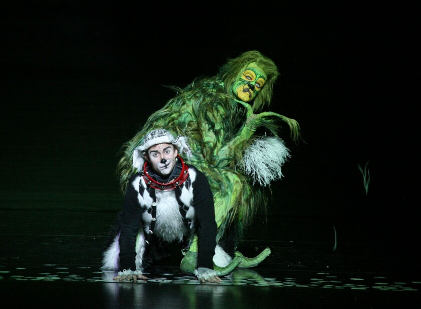 Stefan Karl performs as The Grinch, with Seth Bazacas as Young Max.