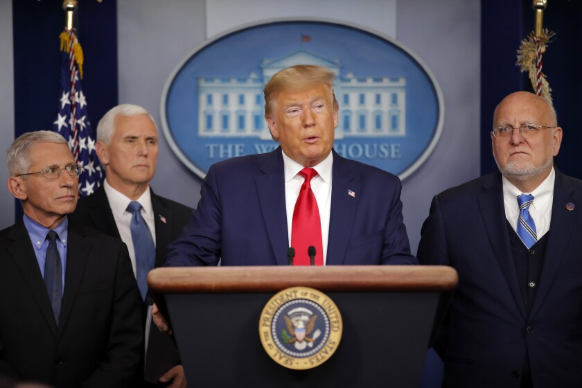 President Trump speaks about the coronavirus on Saturday and is flanked by National Institute for Allergy and Infectious Diseases director Anthony Fauci, Vice President Mike Pence and Robert Redfield, director of the Centers for Disease Control and Prevention.