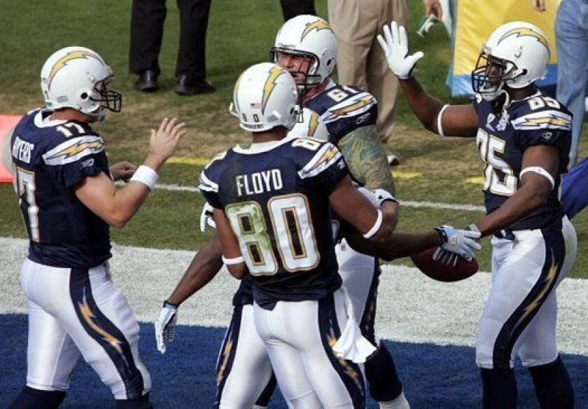 Philip Rivers, Nick Hardwick, Malcom Floyd and Antonio Gates celebrate a Gates touchdown. They are four of the seven Chargers players, along with Jeromey Clary, Mike Scifres and Eric Weddle, that remain from before 2010.