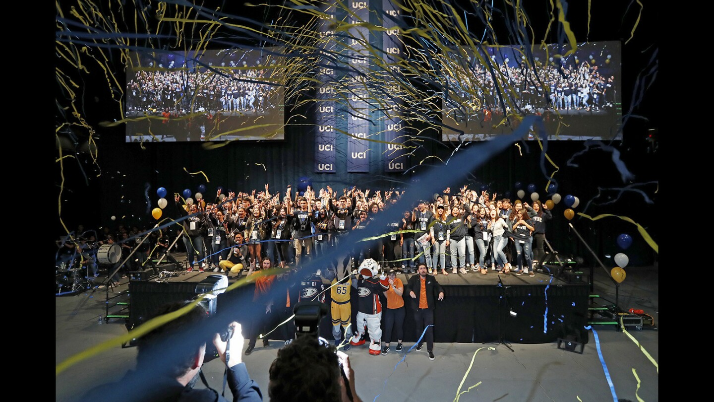 Confetti falls as high school students planning to attend UC Irvine cheer during the finale of a College Signing Day rally Wednesday at UCI's Bren Events Center.