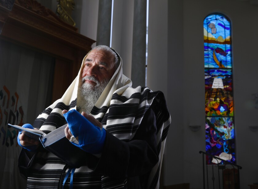 Rabbi Yisroel Goldstein in the sanctuary at Chabad of Poway, June 13, 2019 in Poway, California. He was shot in the hands when a gunman opened fire at the synagogue with an assault style rifle on April 27, on last day of the Passover holiday, during Sabbath services. Lori Gilbert Kaye, a member of the synagogue, was was killed during the attack, and others were also injured.