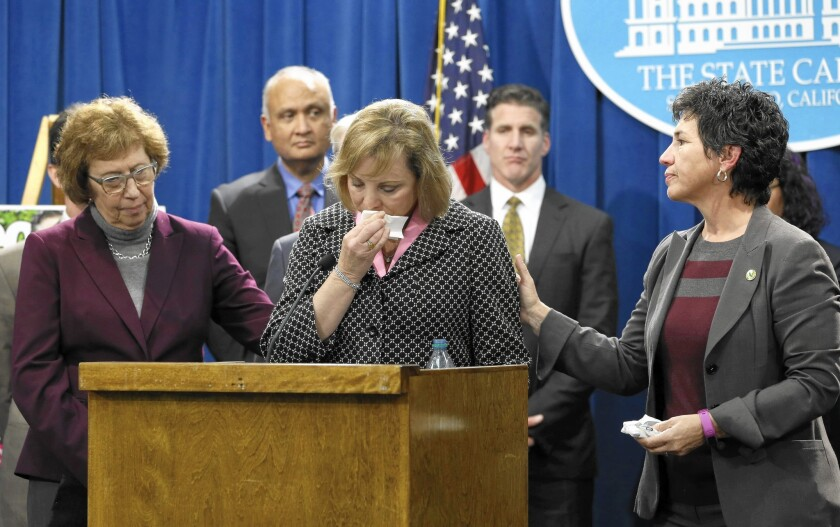 Debbie Ziegler, center, the mother of Brittany Maynard, is comforted by Sen. Lois Wolk, left, and Assemblywoman Susan Talamantes Eggman at a Capitol news conference.