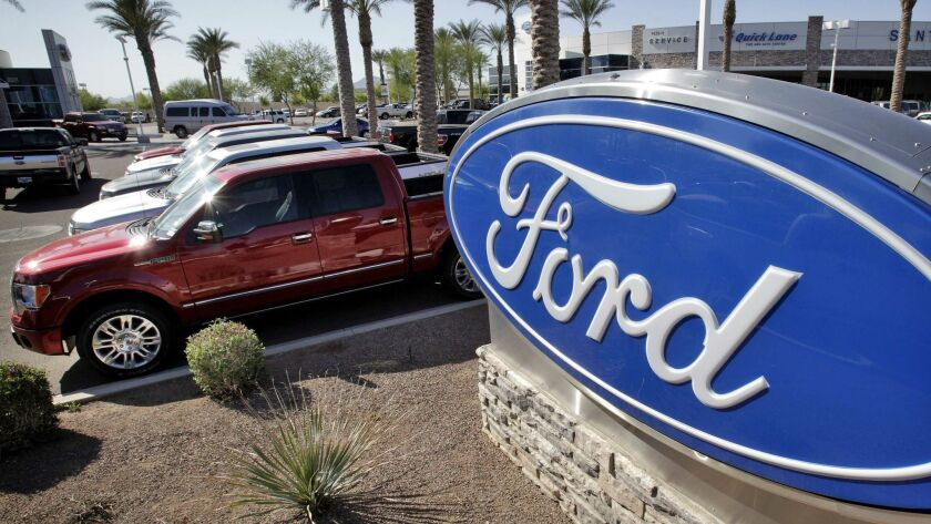 In this March 29, 2011 photo, new 2011 Ford F-150 trucks are shown at a dealership in Glbert, Ariz.