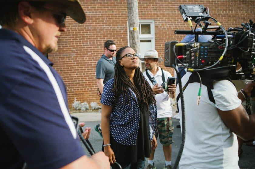 "Director-executive producer Ava DuVernay, center, on the set of ""Selma."""