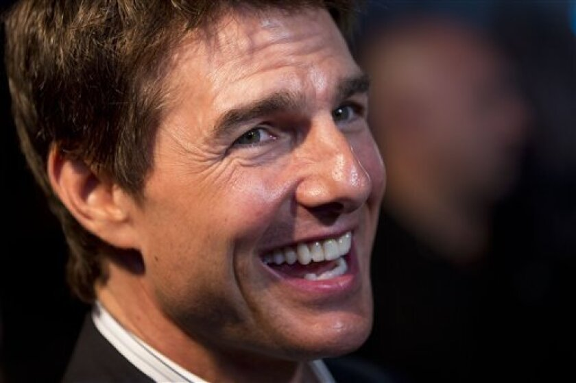 """U.S. actor Tom Cruise smiles as he's photographed by fans during the premiere of his new sci-fi action movie """"Oblivion"""" in Rio de Janeiro, Brazil, Wednesday, March 27, 2013. (AP Photo/Felipe Dana)"""