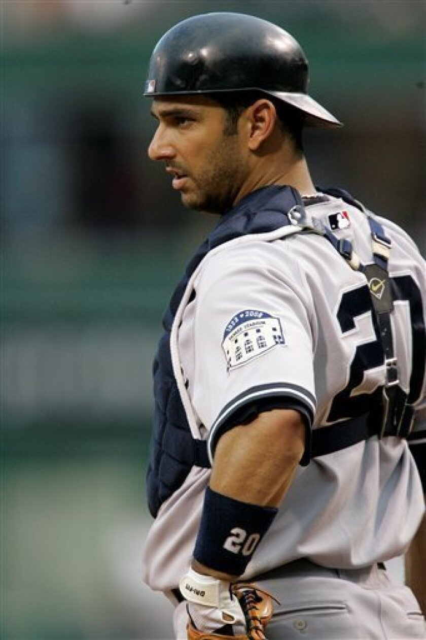 In this June 25, 2008 file photo, New York Yankees catcher Jorge Posada looks on during a baseball game against the Pittsburgh Pirates in Pittsburgh. The Yankees placed Posada on the 15-day disabled list Monday, July 21, 2008 with an injured right shoulder, leaving the All-Star catcher's season in doubt. (AP Photo/Gene J. Puskar, File)