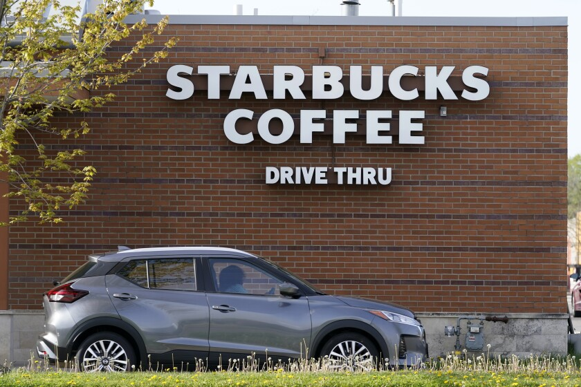 A customers exits the drive thru lane at a Starbucks coffee shop in Des Moines, Iowa.