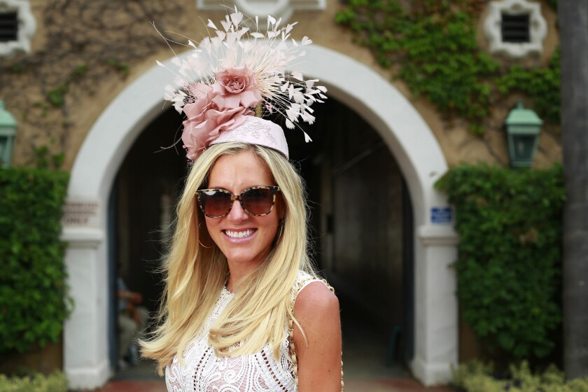 Courtney Sonnenberg shows off her hat on Opening Day at the Del Mar Thoroughbred Club on July 19, 2017.