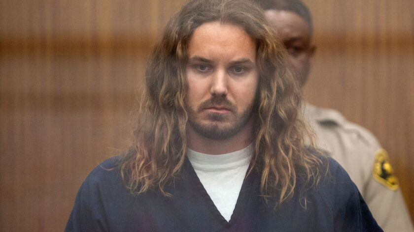 A judge last week lowered bail for rock singer Timothy Lambesis, pictured at his arraignment May 9,