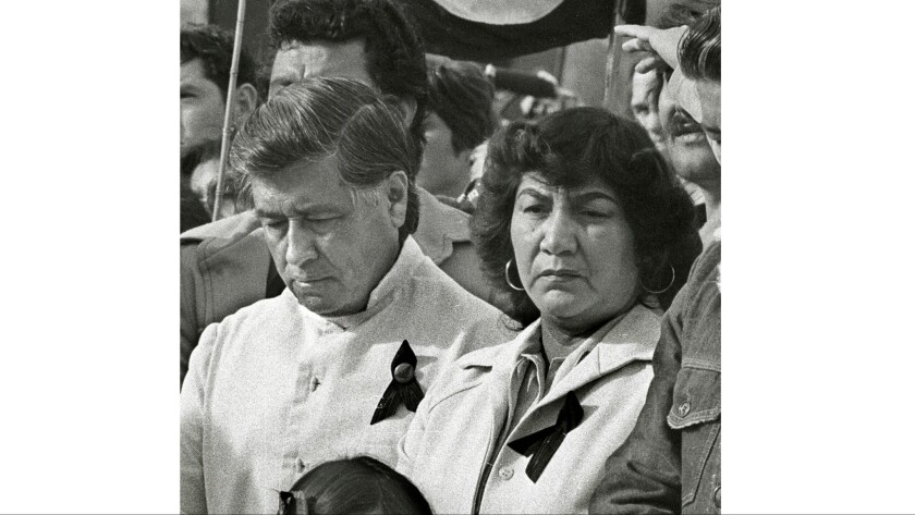 In this file photo, Cesar Chavez and his wife Helen are seen at the graveside service for slain farm worker Rufino Contraras. Helen Chavez died Monday at age 88.