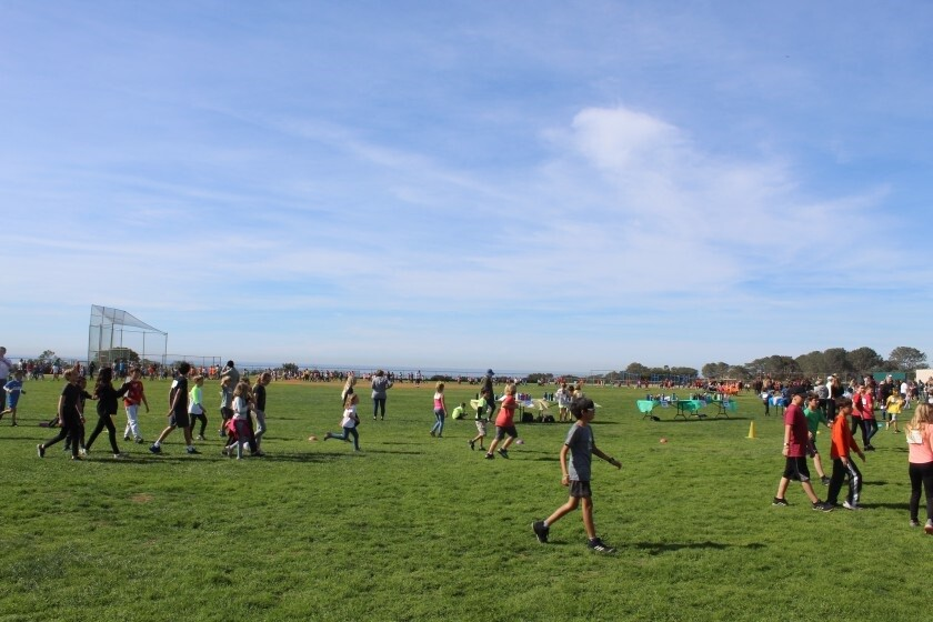 Students on the Del Mar Heights field during a jogathon held earlier this year.