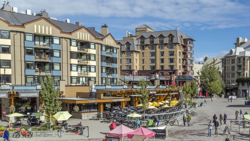Visitors on Skiers Plaza and Village Stroll at dusk, Whistler, British Columbia, Canada, North America