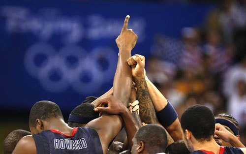 Team USA gathers at center court moments after defeating Argentina, 101-81, in the Olympic men's basketball semifinal in Beijing. The team faces Spain in the gold medal game Sunday.