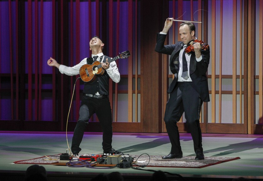 "Ukulele virtuoso Jake Shimabukuro and violinist William Fedkenheuer played an animated, vocal-free version of The Beatles' ""While My Guitar Gently Weeps"" at the Friday, April 5 opening of The Conrad Prebys Performing Arts Center in La Jolla."