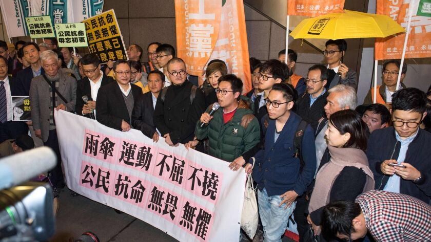 Activists from Hong Kong's 'Umbrella Movement' speak to supporters before their arrest in Hong Kong