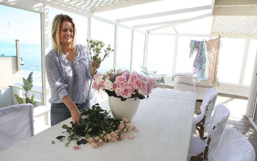 """""""It's really about the romance and femininity of flowers that's important,"""" says Rachel Ashwell, author of the new book """"The World of Shabby Chic: Beautiful Homes, My Story & Vision."""""""