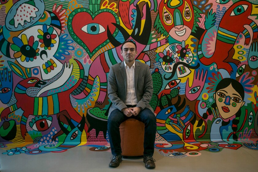 Diego Bassante, a former Ecuadoran diplomat, now manages Facebook's politics and government outreach for Latin America, training politicians and officials in how to use the service. He's pictured in front of a mural at Facebook's Mexico City headquarters.