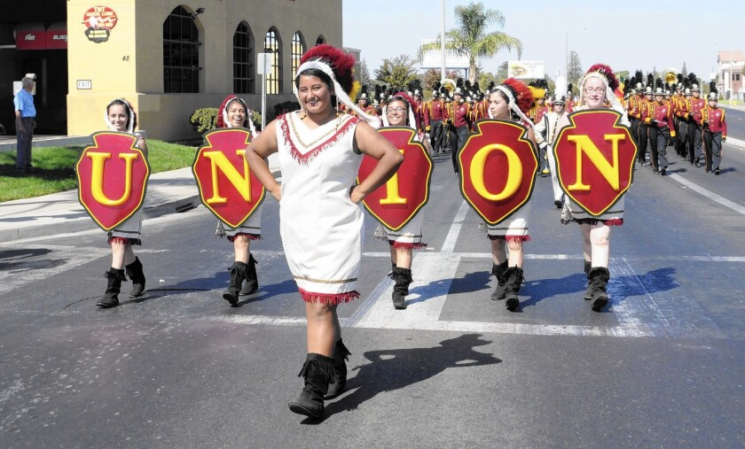 Tulare Union High School's Redskins mascot permeates student life, extending to the costumes worn and signs carried by students in parades. Under a new state law, the school must replace its nickname with a new one by 2017.