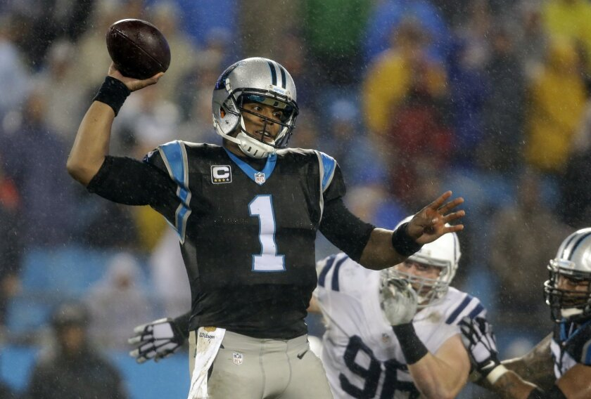 Carolina Panthers' Cam Newton (1) looks to pass against the Indianapolis Colts in the second half of an NFL football game in Charlotte, N.C., Monday, Nov. 2, 2015. (AP Photo/Bob Leverone)