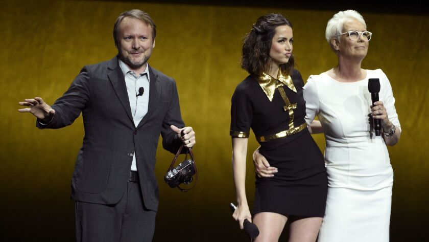 "Rian Johnson, director of the upcoming film ""Knives Out,"" discusses the film alongside cast members Jamie Lee Curtis and Ana de Armas during the Lionsgate presentation at CinemaCon in Las Vegas."
