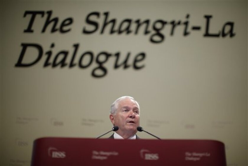 U.S. Secretary of Defense Robert Gates makes a keynote speech at the 10th International Institute for Strategic Studies (IISS) Asia Securities Summit in Singapore Saturday, June 4, 2011. (AP Photo/Jason Reed, Pool)