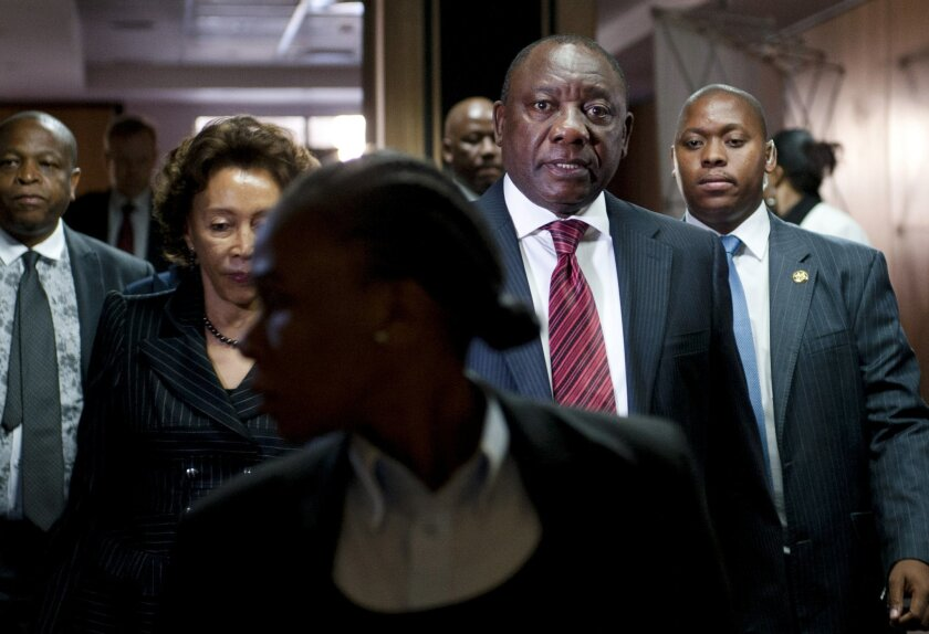 This photo taken Monday, Aug. 11 2014 shows newly elected deputy president Cyril Ramaphosa arrives at the Marikana commission of inquiry in Centurion, South Africa. Ramaphosa, a former union leader and businessman testified Monday and Tuesday Aug. 12, 12 2014, before a panel that is investigating the killings of several dozen people who were killed during labor unrest at platinum mine operations in Marikana in 2012. (AP Photo)