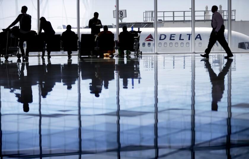 A Delta Air Lines jet sits at a gate at Hartsfield-Jackson Atlanta International Airport.