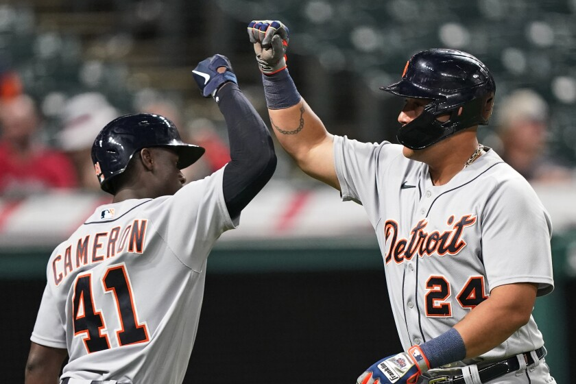 Detroit Tigers' Miguel Cabrera, right, is congratulated by Daz Cameron after Cabrera hit a solo home run during the fifth inning in the second baseball game of the team's doubleheader against the Cleveland Indians, Wednesday, June 30, 2021, in Cleveland. (AP Photo/Tony Dejak)