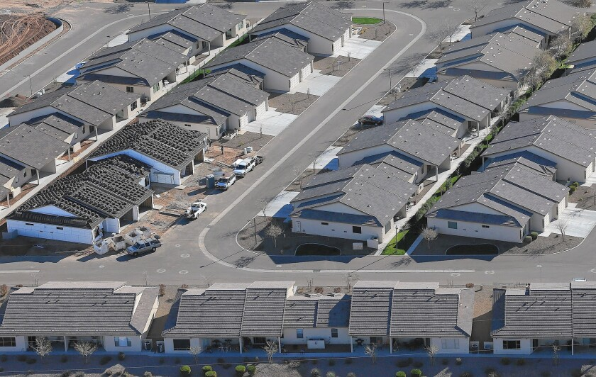 Millions of Americans have stakes in the rules governing credit — especially people who could use a little help to qualify for a mortgage. Above, homes under construction in Mesa, Ariz.