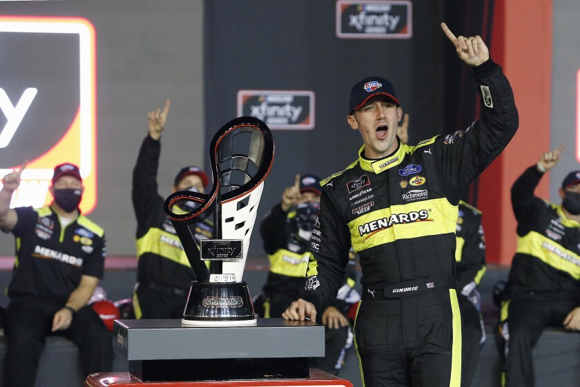 FILE - In this Nov. 7, 2020, file photo, Austin Cindric celebrates in Victory Lane with the series championship trophy after winning the NASCAR Xfinity Series auto race at Phoenix Raceway in Avondale, Ariz. Cindric solidified his standing at Penske by winning six races last year and his first Xfinity Series championship. (AP Photo/Ralph Freso, File)