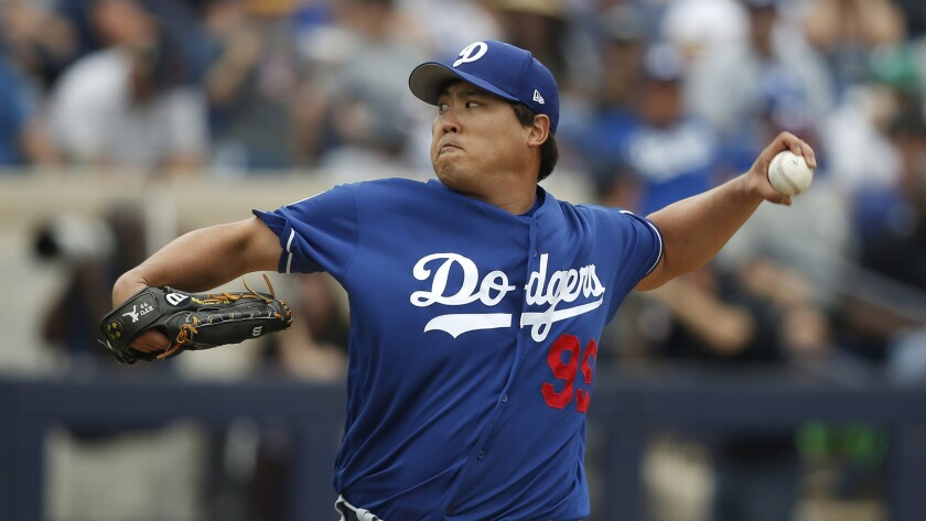Dodgers pitcher Hyun-Jin Ryu delivers during an exhibition game against the Milwaukee Brewers on Thursday.