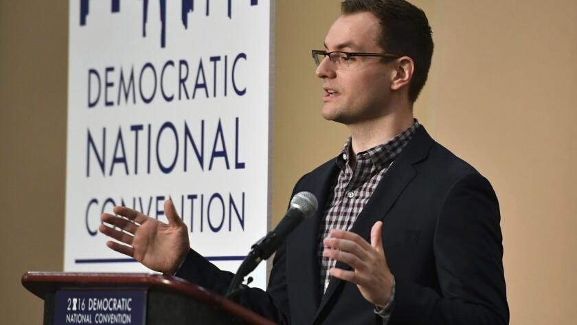 Robby Mook, campaign manager for Hilary for America, speaks at a press conference in the convention center in Philadelphia.