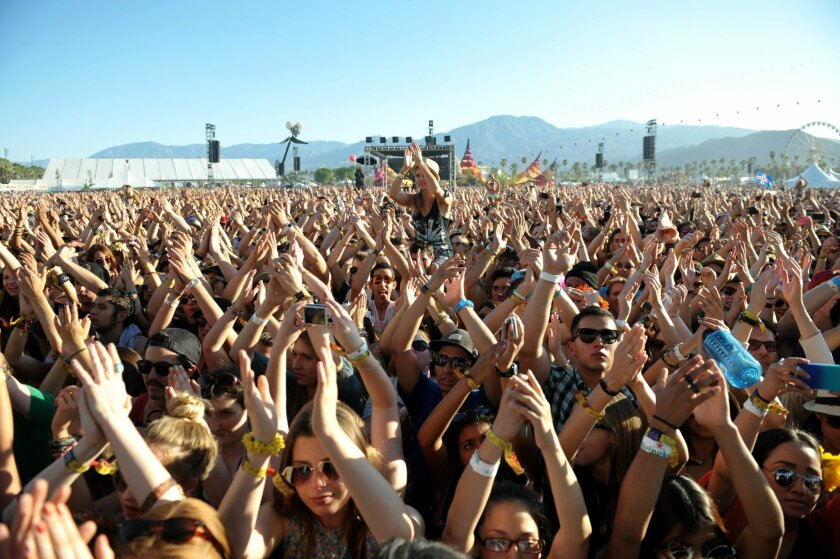 FILE--This 2013 file photo shows part of the crowd at the 2013 Coachella Valley Music and Arts Festival at the Empire Polo Club in Indio, Calif. Dubbed the Desert Trip, a classic-rock concert featuring the Rolling Stones, Bob Dylan, Paul McCartney, Neil Young, Roger Waters and the Who has been set