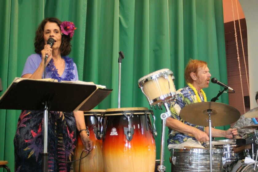 The A-Team band warms up with Hawaiian favorites, followed by dance classics like 'Twist and Shout.'