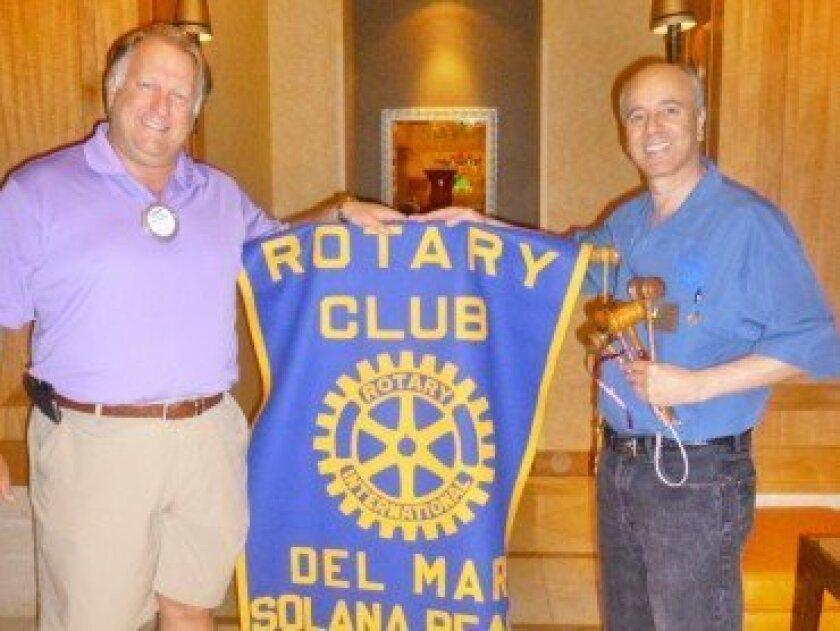 Past President Richard Fogg (left) turning over the Del Mar-Solana Beach Rotary Club presidency to newly-installed President Steven Weitzen (right).