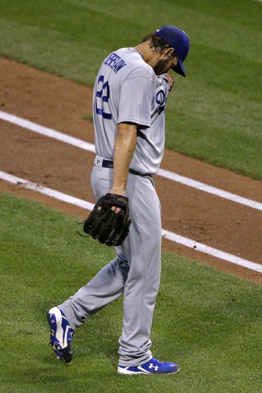Los Angeles Dodgers starting pitcher Clayton Kershaw walks to the dugout after giving up four runs in the second inning of a baseball game against the Pittsburgh Pirates in Pittsburgh, Sunday, June 26, 2016. (AP Photo/Gene J. Puskar)
