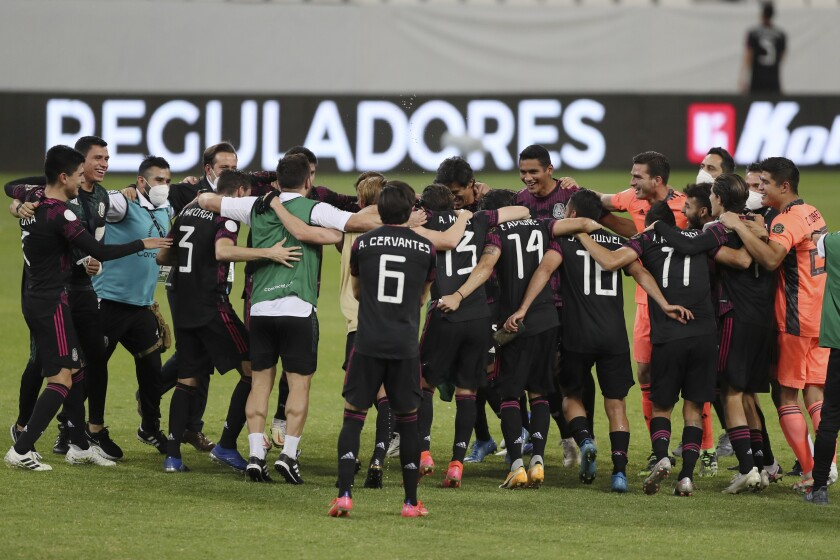 Mexico's players celebrates at the end of a Concacaf Men's Olympic qualifying championship semi-final soccer match against Canada in Guadalajara, Mexico, Sunday, March 28, 2021. Mexico defeated Canada 2-0, qualifying for the upcoming Tokyo Olympics. (AP Photo/Fernando Llano)