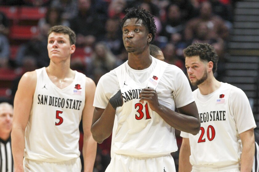 SDSU is still hoping to get Nathan Mensah (center) back for the NCAA Tournament next week.