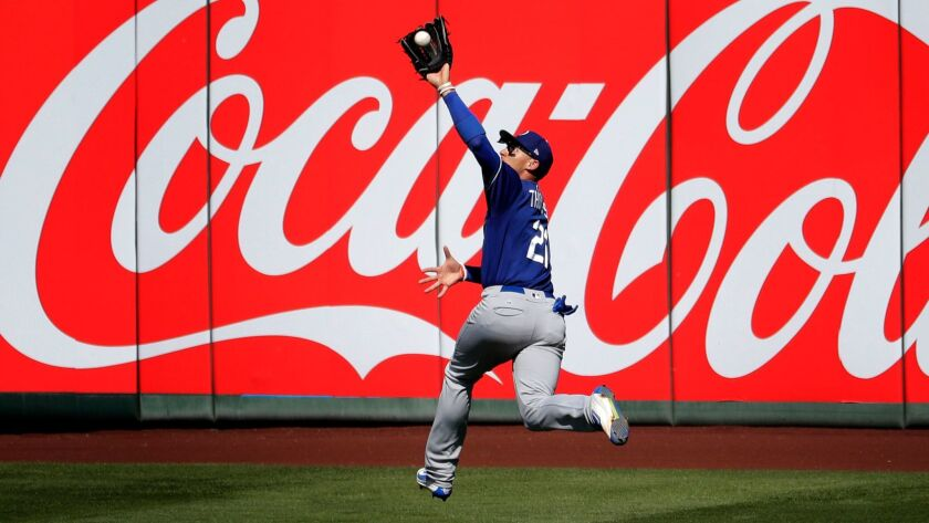 Los Angeles Dodgers center fielder Trayce Thompson catches a fly out by Los Angeles Angels' Mike Tro