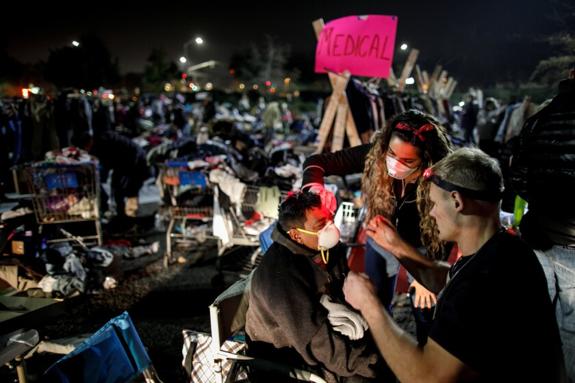 CHICO, CALIF. -- TUESDAY, NOVEMBER 13, 2018: Joshua Crane and Vanessa Ruelas, both volunteers at a m