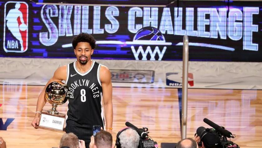 Spencer Dinwiddie from the Brooklyn Nets holds the trophy after winning the Taco Bell Skills Challenge at Staples Center in Los Angeles, California, USA, 17 February 2018. EFE
