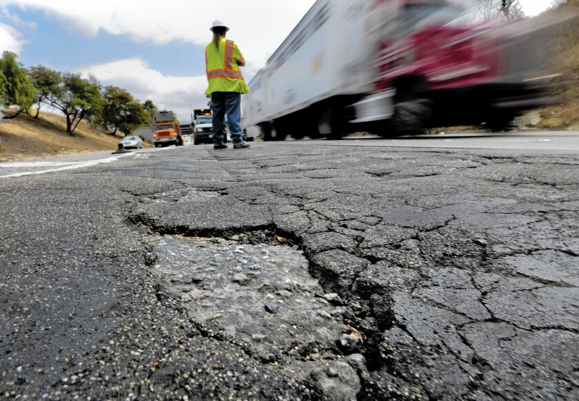 California Gov. Jerry Brown says the state gasoline tax is generating $2.3 billion annually for highway repairs, but $5.7 billion more is needed.
