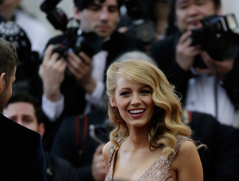 Blake Lively, seen here at the Costume Institute Gala at New York's Metropolitan Museum of Art in May, is on the August 2014 cover of Vogue.
