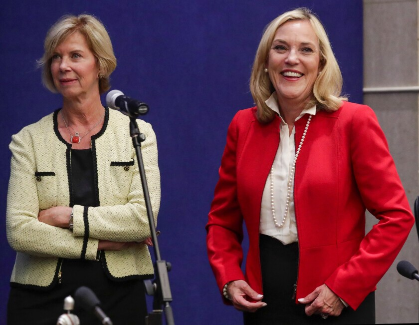L.A. County Supervisor Kathryn Barger, at right, with Supervisor Janice Hahn, said the county was progressing in its coronavirus fight and would ask the state for to allow it to advance farther into Gov. Gavin Newsom's phased reopening plan.