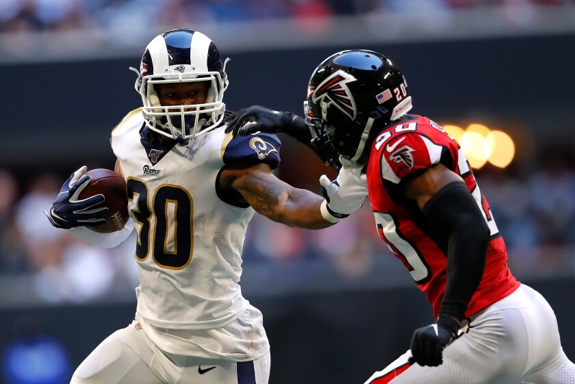 Rams running back Todd Gurley run against the Atlanta Falcons' Kendall Sheffield Sunday in Atlanta.